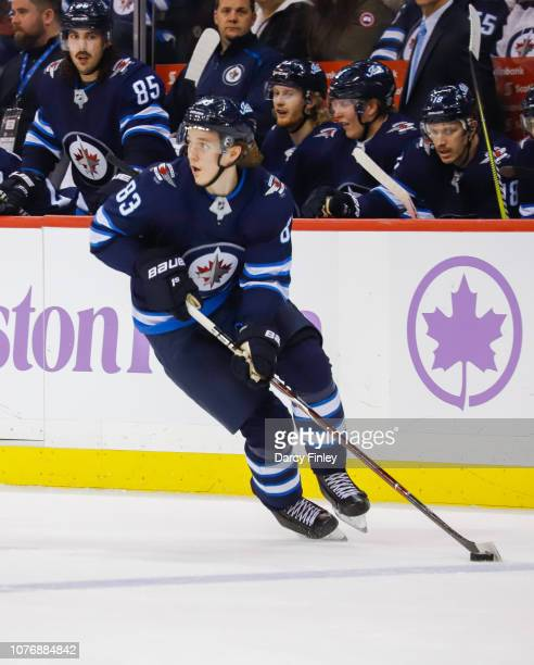Sami Niku of the Winnipeg Jets plays the puck down the ice during third period action against the Chicago Blackhawks at the Bell MTS Place on...