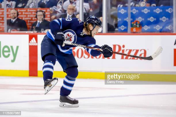 Sami Niku of the Winnipeg Jets shoots the puck towards the net during first period action against the Ottawa Senators at the Bell MTS Place on...