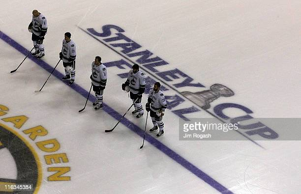 Sami Salo Mason Raymond Christian Ehrhoff Ryan Kesler and Christopher Higgins of the Vancouver Canucks stand on the ice prior to Game Six against the...