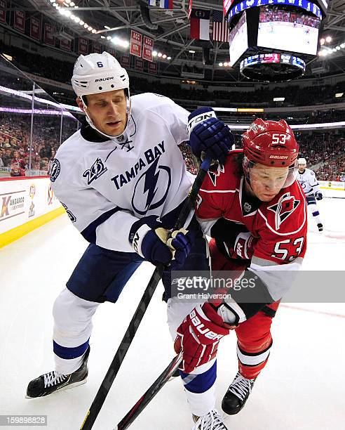 Sami Salo of the Tampa Bay Lightning battles for position with Jeff Skinner of the Carolina Hurricanes during play at PNC Arena on January 22 2013 in...