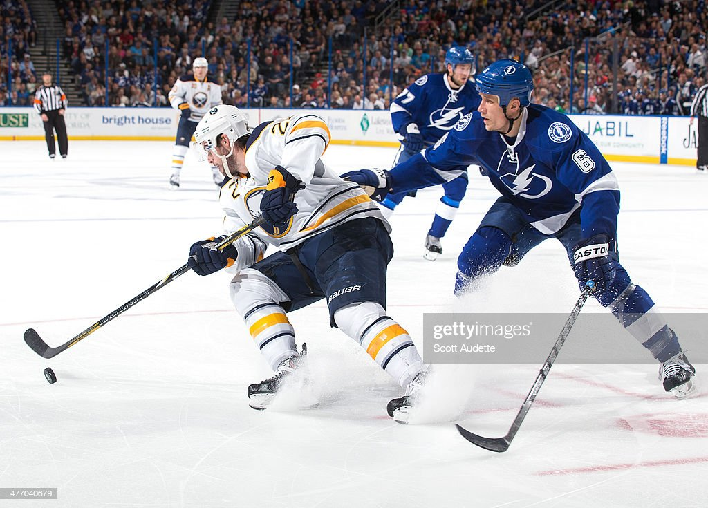 Sami Salo #6 of the Tampa Bay Lightning battles for the puck against Drew Stafford #21 of the Buffalo Sabres during the third period at the Tampa Bay Times Forum on March 6, 2014 in Tampa, Florida.
