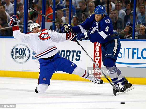 Sami Salo of the Tampa Bay Lightning checks Thomas Vanek of the Montreal Canadiens in Game Two of the First Round of the 2014 Stanley Cup Playoffs at...