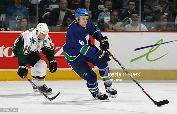 Sami Salo of the Vancouver Canucks skates with the puck against Brenden Morrow of the Dallas Stars during Game 7 of the 2007 Western Conference...