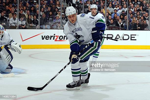 Sami Salo of the Vancouver Canucks skates with the puck against the Los Angeles Kings in Game Four of the Western Conference Quarterfinals during the...
