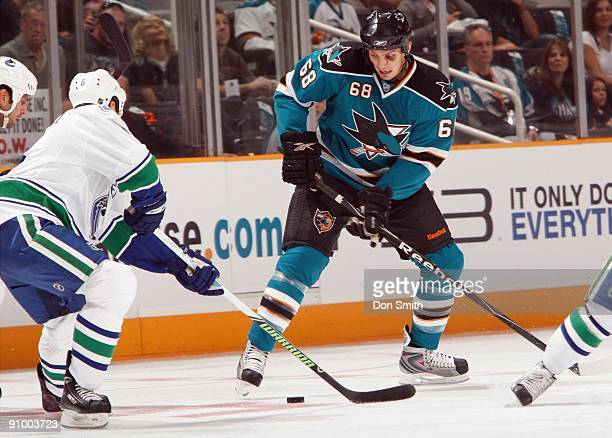 Sami Salo of the Vancouver Canucks tries to challenge Frazer McLaren of the San Jose Sharks during an NHL Preseason game on September 18 2009 at HP...