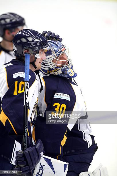 Sami Sandell and Bernd Bruckler celebrate during the IIHF Champions Hockey League match between HV 71 Joenkoeping and Espoo Blues on December 3, 2008...