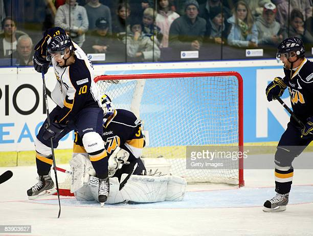 Sami Sandell fights for the puck during the IIHF Champions Hockey League match between HV 71 Joenkoeping and Espoo Blues on December 3, 2008 in...