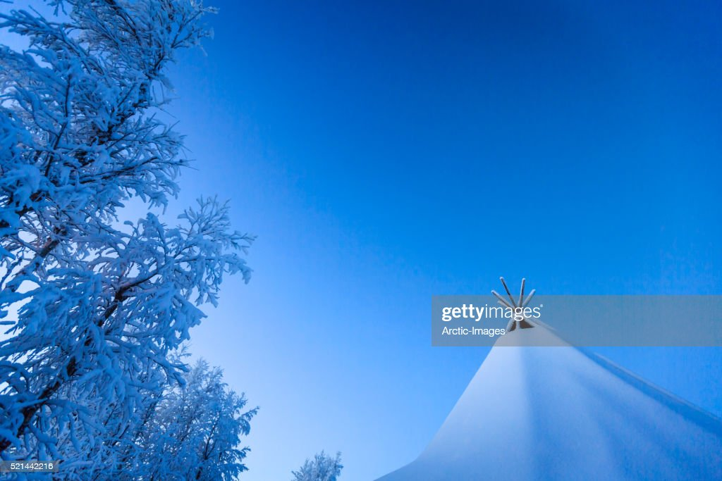Sami tent with snow covered trees Jukkasjarvi Lapland Sweden & Sami Tent With Snow Covered Trees Jukkasjarvi Lapland Sweden Stock ...