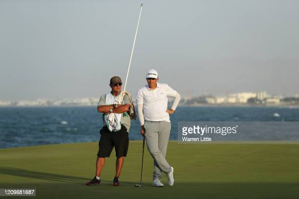 Sami Valimaki of Finland and caddie Kyle Roadley look on in the first play off hole against Brandon Stone of South Africa during the final round of...