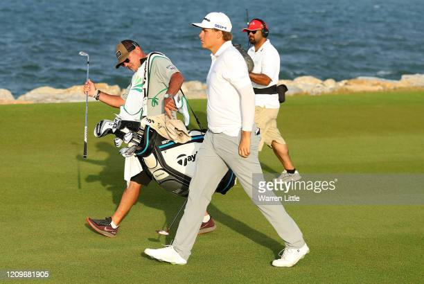 Sami Valimaki of Finland and caddie Kyle Roadley walk down the 18th hole in the third play off hole against Brandon Stone of South Africa during the...