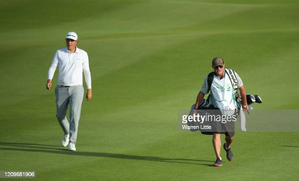 Sami Valimaki of Finland and caddie Kyle Roadley walk down the 18th hole in the second play off hole against Brandon Stone of South Africa during the...