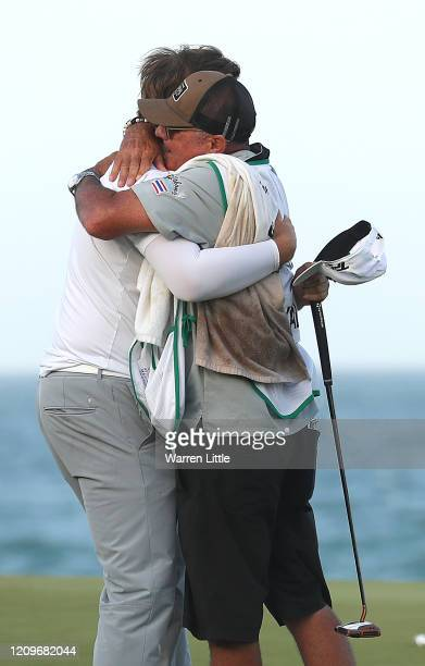 Sami Valimaki of Finland celebrates with caddie Kyle Roadley on the 18th green after winning the Oman Open at Al Mouj Golf Complex on March 01 2020...