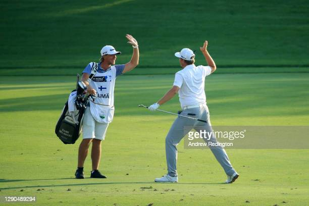 Sami Valimaki of Finland celebrates with his caddy after Sami Valimaki holds his third shot for an eagle on the 18th hole during Day One of the DP...