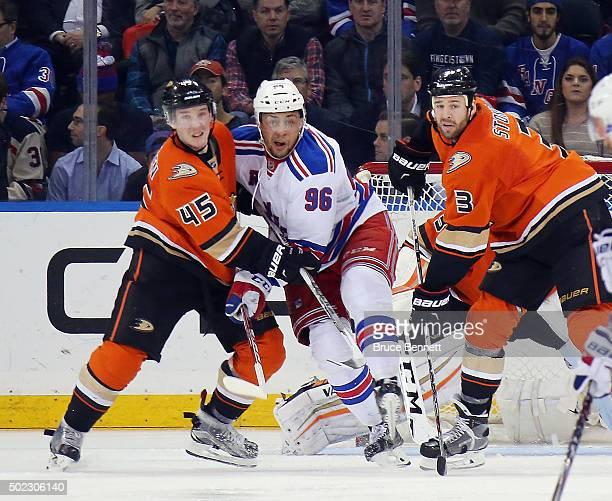 Sami Vatanen and Clayton Stoner of the Anaheim Ducks go up against Emerson Etem of the New York Rangers at Madison Square Garden on December 22 2015...