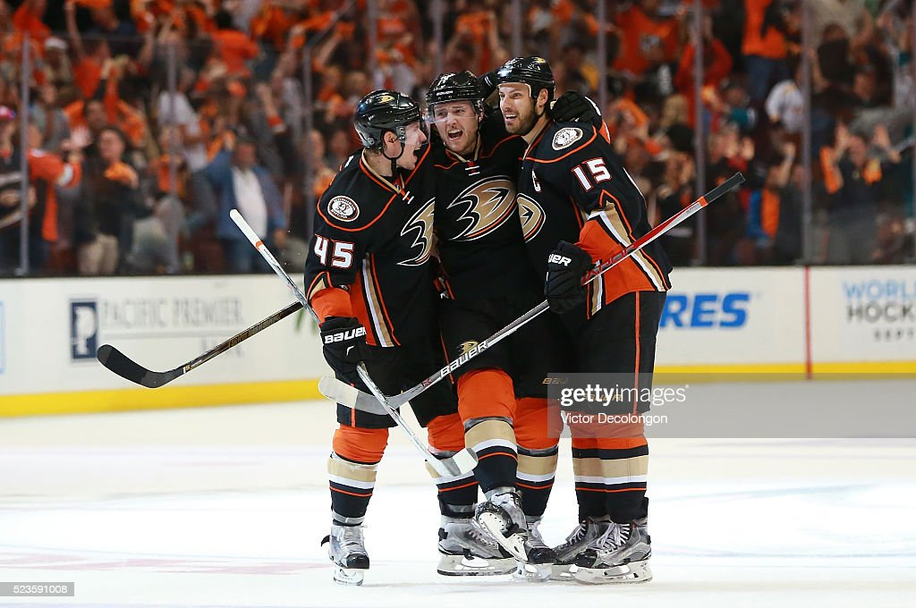Sami Vatanen #45, Cam Fowler #4 and Ryan Getzlaf #15 of the Anaheim Ducks celebrate Fowler's power-play goal at center ice in the third period of Game Five of the Western Conference First Round against the Nashville Predators during the 2016 NHL Stanley Cup Playoffs at Honda Center on April 23, 2016 in Anaheim, California. The Ducks defeated the Predators 5-2.