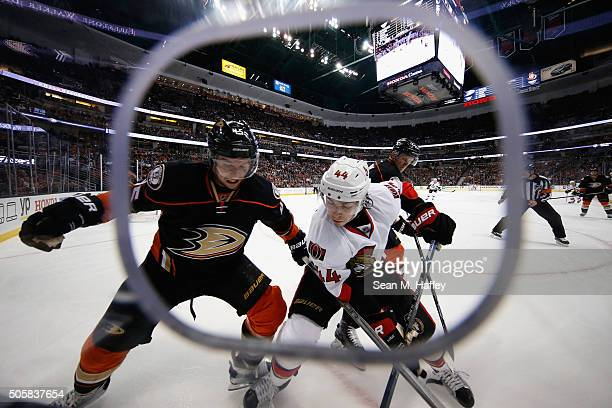 Sami Vatanen of the Anaheim Ducks battles JeanGabriel Pageau of the Ottawa Senators for postion during the first period of a game at Honda Center on...