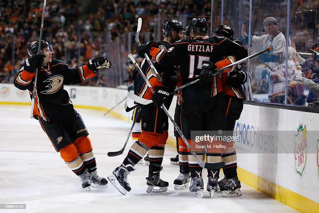 Sami Vatanen #45 of the Anaheim Ducks, Jakob Silfverberg #33 of the Anaheim Ducks, Ryan Getzlaf #15 of the Anaheim Ducks react to a goal during the third period of a game against the Calgary Flames at Honda Center on November 24, 2015 in Anaheim, California.