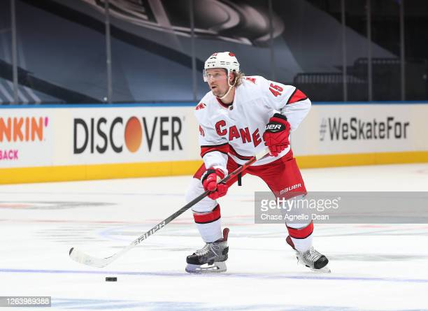 Sami Vatanen of the Carolina Hurricanes controls the puck in the first period of Game Three of the Eastern Conference Qualification Round against the...