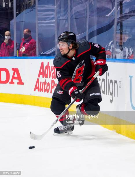 Sami Vatanen of the Carolina Hurricanes plays the puck against the New York Rangers during the second period in Game Two of the Eastern Conference...