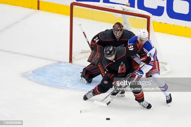 Sami Vatanen of the Carolina Hurricanes shields the puck from Kaapo Kakko of the New York Rangers during the first period of Game Two of the Eastern...
