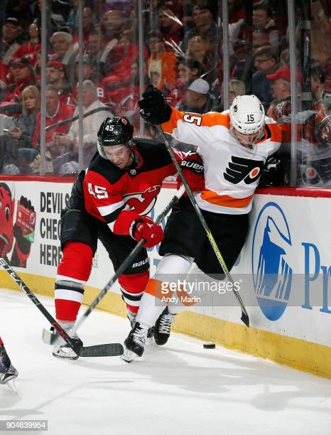 Sami Vatanen of the New Jersey Devils and Jori Lehtera of the Philadelphia Flyers battle for position during the game at Prudential Center on January...