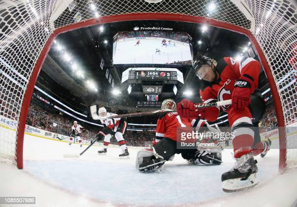 Sami Vatanen of the New Jersey Devils blocks a shot by Brady Tkachuk of the Ottawa Senators during the second period at the Prudential Center on...