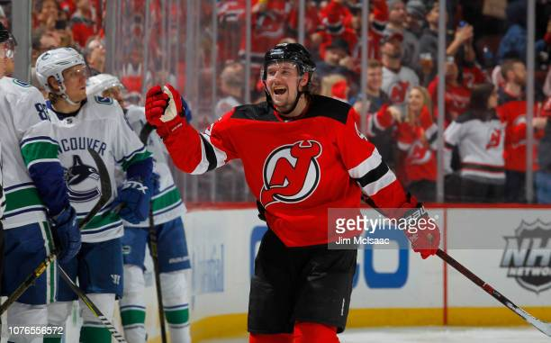 Sami Vatanen of the New Jersey Devils celebrates his third period goal against the Vancouver Canucks with his teammates at Prudential Center on...
