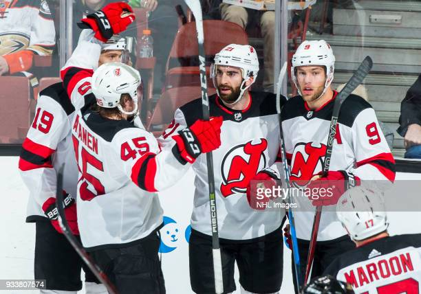 Sami Vatanen of the New Jersey Devils joins Travis Zajac Kyle Palmieri and Taylor Hall to celebrate Palmieri's secondperiod goal during the game...