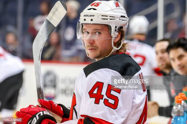 Sami Vatanen of the New Jersey Devils looks on during the pre-game warm up prior to NHL action against the Winnipeg Jets at the Bell MTS Place on...