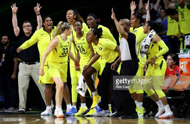 Sami Whitcomb of the Seattle Storm celebrates with the bench after hitting a three pointer against the Washington Mystics in the second half during...