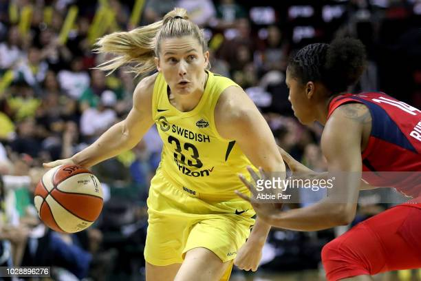 Sami Whitcomb of the Seattle Storm handles the ball against Tierra RuffinPratt of the Washington Mystics in the second quarter during game one of the...