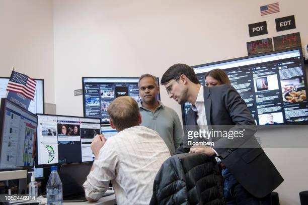Samidh Chakrabarti head of civic engagement for Facebook Inc center and Nathaniel Bleacher head of cyber security policy for Facebook Inc right work...