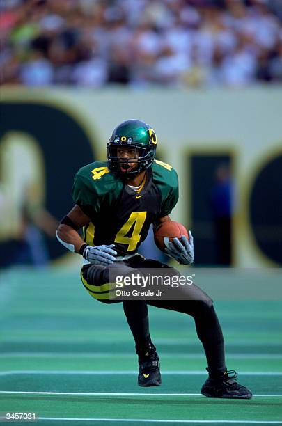 Samie Parker of the University of Oregon takes possession of the ball during the game at Autzen Stadium on September 30 2000 in Eugene Oregon Oregon...