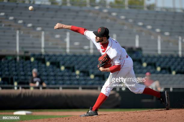 Samil De Los Santos of Scottsdale Scorpions delivers a pitch in the Arizona Fall League game against the Surprise Saguaros at Scottsdale Stadium on...