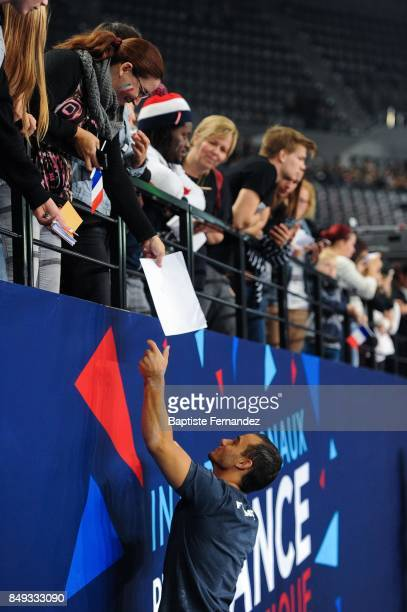 Samir Ait Said of France signs autographs for the fans during the FIG World Cup Challenge 'Internationaux de France' at AccorHotels Arena on...