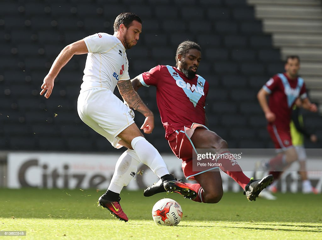 Samir Carruthers of Milton Keynes Dons contests the ball with Anthony Grant of Port Vale during the Sky Bet League One match between Milton Keynes Dons and Port Vale at StadiumMK on October 9, 2016 in Milton Keynes, England.