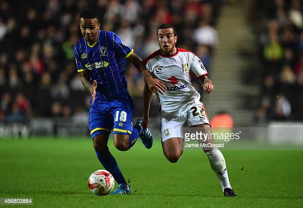 Samir Carruthers of MK Dons battles with Jake Nicholson of AFC Wimbledon during the Johnstone's Paint Trophy Southern Section Second Round match...