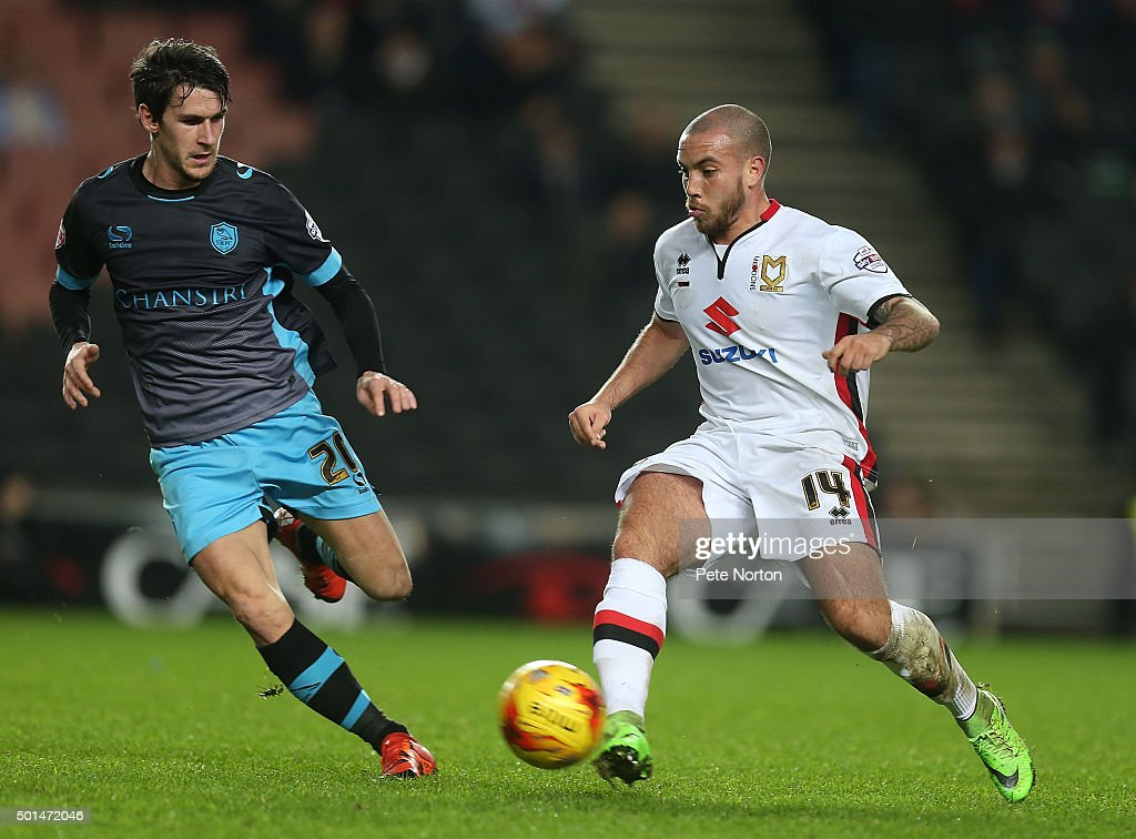 Samir Caruthers of Milton Keynes Dons plays the ball watched by Kieran Lee of Sheffield Wednesday during the Sky Bet Championship match between Milton Keynes Dons and Sheffield Wednesday at stadium:mk on December 15, 2015 in Milton Keynes, United Kingdom.