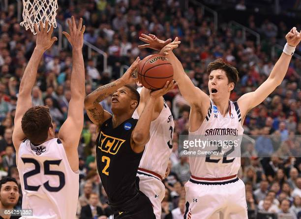 Samir Doughty of the Virginia Commonwealth Rams is defended by Joe Rahon and Dane Pineau of the St Mary's Gaels during the first round of the 2017...