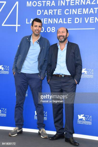 Samir Guesmi and Kad Merad attend the 'La Melodie' photocall during the 74th Venice Film Festival on September 2 2017 in Venice Italy