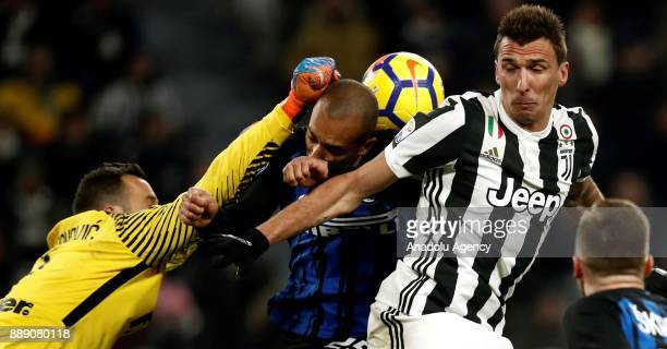 Samir Handanovic and Joao Miranda of FC Internazionale in action against Mario Mandzukic of FC Juventus during the Serie A football match between FC...