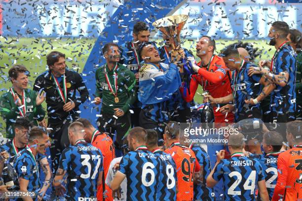 Samir Handanovic and Lautaro Martinez of Internazionale lift the Scudetto trophy together following the Serie A match between FC Internazionale...