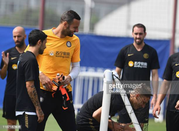 Samir Handanovic and Nicolo Barella of FC Internazionale react during a training session on July 22 2019 in Nanjing