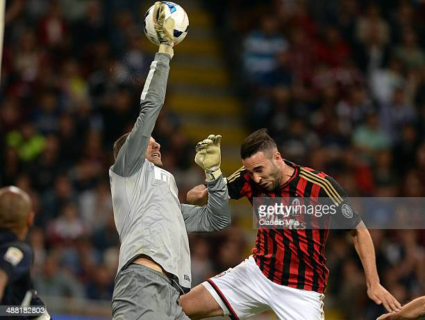 Samir Handanovic of FC Inter Milan and Adil Rami of AC Milan during the Serie A match between AC Milan and FC Internazionale Milano at Stadio...