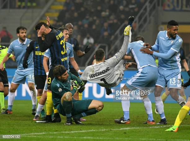 Samir Handanovic of FC Internazionale and Federico Marchetti of SS Lazio compete for the ball during the TIM Cup match between FC Internazionale and...