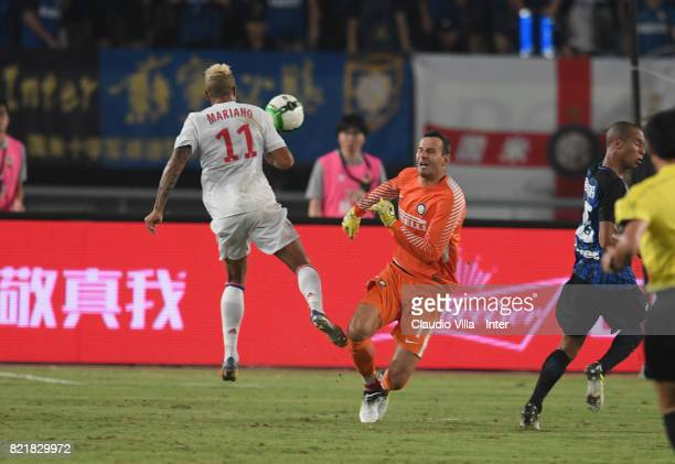 Samir Handanovic of FC Internazionale and Mariano of Olympique Lyonnais compete for the ball during the 2017 International Champions Cup match...