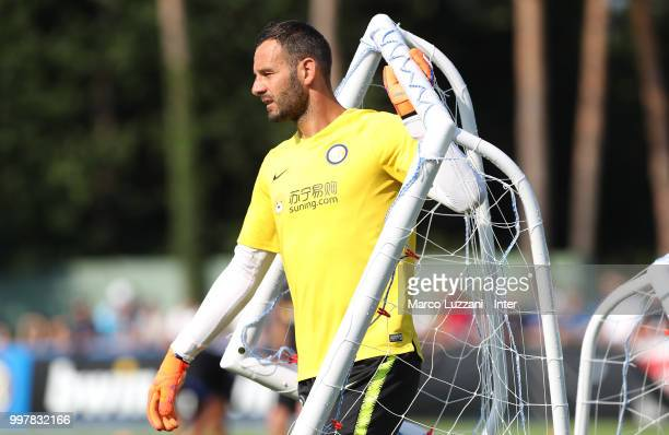 Samir Handanovic of FC Internazionale carries a net during the FC Internazionale training camp at the club's training ground Suning Training Center...