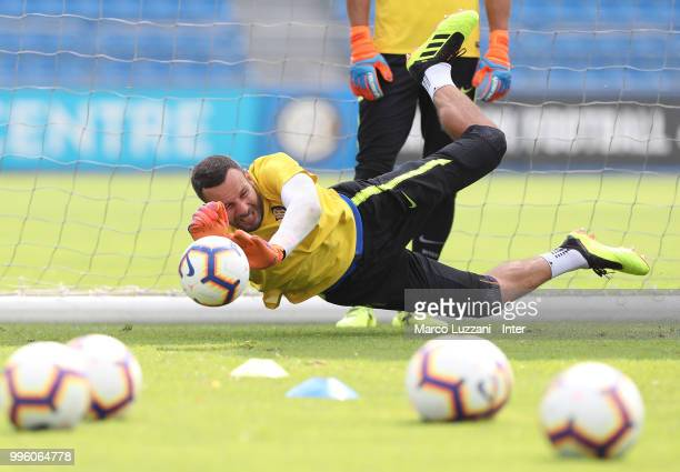 Samir Handanovic of FC Internazionale dives to save a shot during the FC Internazionale training session at the club's training ground Suning...