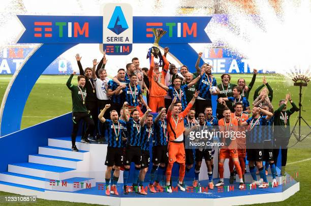 Samir Handanovic of FC Internazionale lifts the Scudetto trophy as players of FC Internazionale celebrate during the award ceremony after the Serie A...