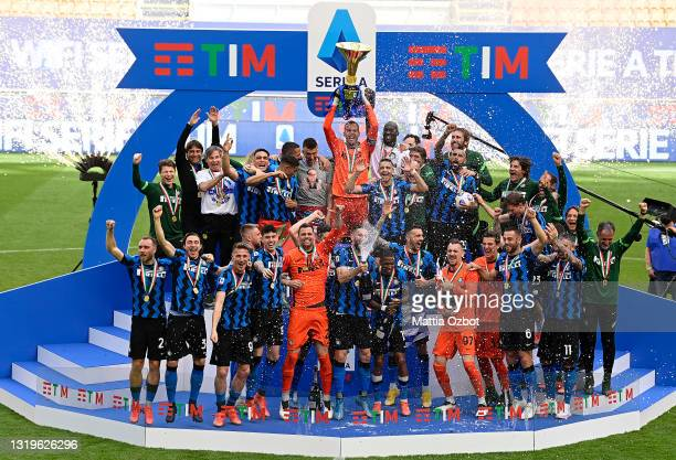 Samir Handanovic of FC Internazionale lifts the Serie A Trophy whilst his team mates celebrate after the Serie A match between FC Internazionale...